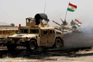 Kurdish Peshmerga troops secure an area in the town of Sulaiman Pek